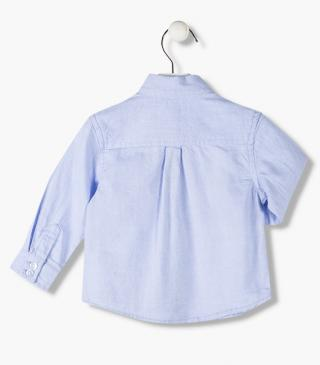 Blue long sleeve shirt with embroidery.