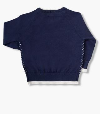 Knit jumper featuring a button opening at the armholes.