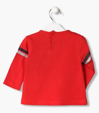 Red t-shirt with glittery stripes.