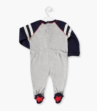 Sleepsuit featuring a gummed print to the front.