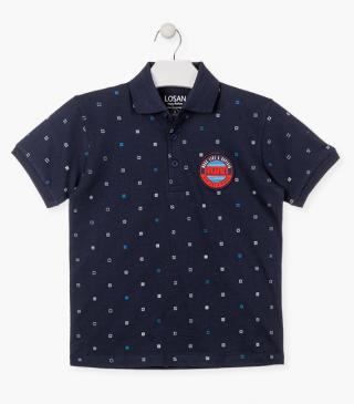 All-over print polo with patch on the chest.