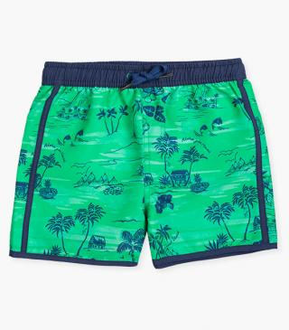Green swim trunks with tropical print.
