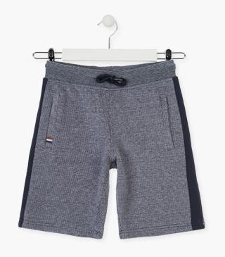 Grey swim trunks with side stripes.