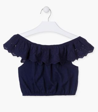 Blue top with ruffle detail.