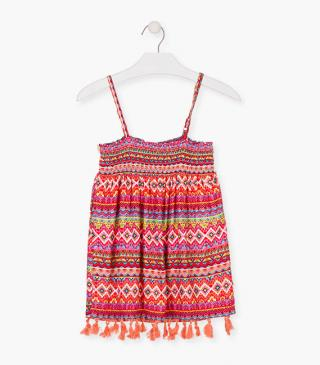 Ethnic print sleeveless blouse.