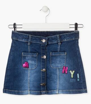 Denim skirt with sequin patches.