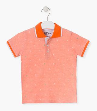 Orange polo with palm trees.