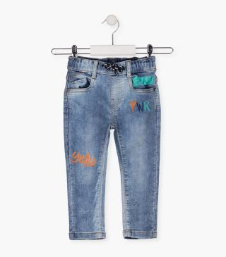Jeans with rainbow motif.