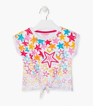 T-shirt with colourful stars printed at the front.