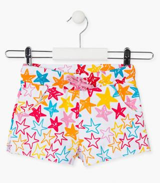 All-over star print shorts.