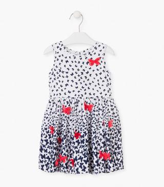 Crepe dress with butterfly motif.