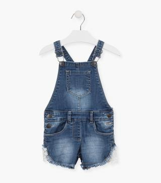 Denim dungaree with crochet inserts.