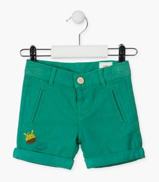 Green shorts with patches.
