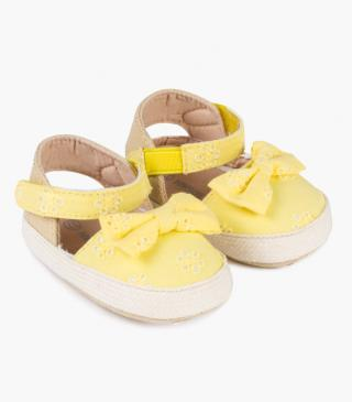 Voile shoes with yellow embroidered flowers.