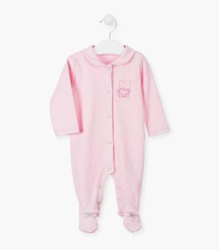 Pink sleepsuit with floral print.