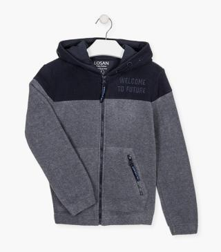 Fleece jacket with embroidered graphic.