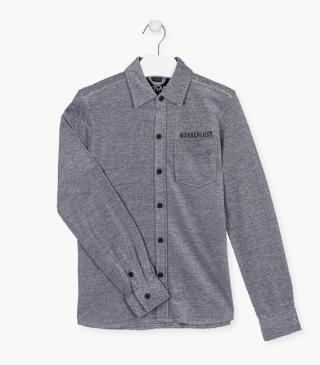 Embroidered shirt with long sleeves.