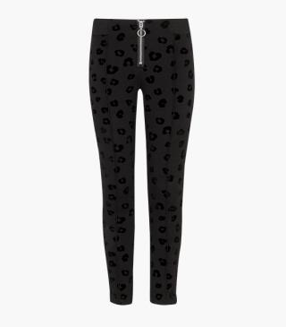 Velvety animal print trousers.