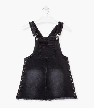 Black denim pinafore dress.