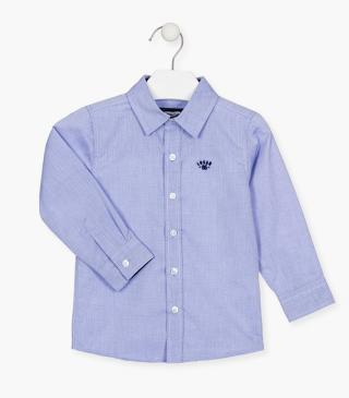 Blue shirt with chest embroidery.