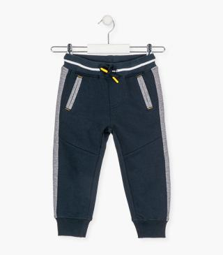 Blue joggers with front pockets.