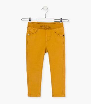 Coloured denim effect jersey trousers.