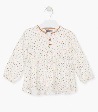 All-over floral print blouse.