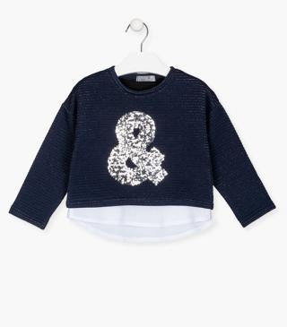 Fabric mix sweatshirt with sequined front.