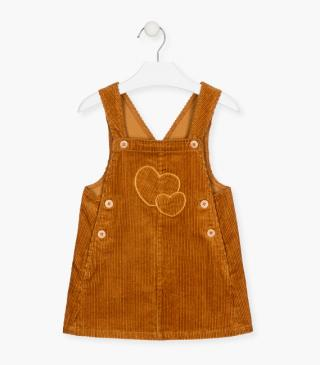 Dungaree with embroidered hearts at the chest.