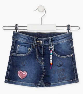 Mini-skirt with heart-shaped sequined patch.