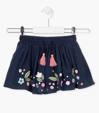 Skirt with patches and embroidered flowers on hem.
