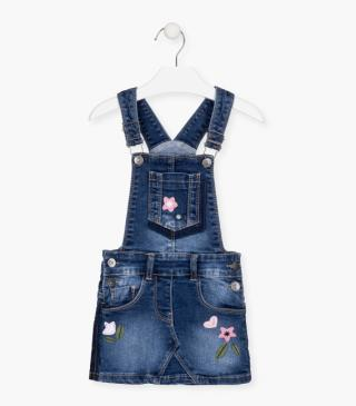 Pinafore dress with floral patches.