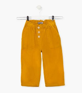Micro-corduroy trousers with elasticated waist.