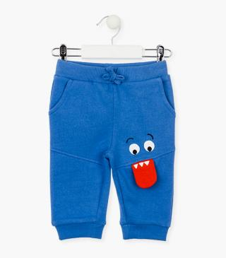 Plush trousers with printed face.