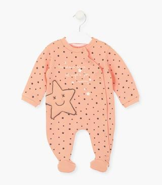Pink sleepsuit with little stars.