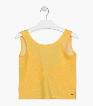 Yellow tee with opening at the back.
