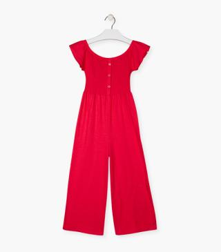 Red knit dungaree.