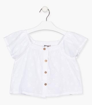 Short sleeve blouse with floral embroidery.