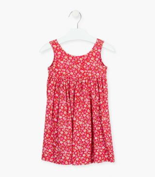 Sleeveless dress with floral motif.