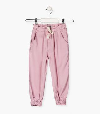 Pink trousers.