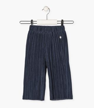 Loose pleated trousers.