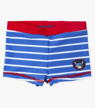 Swim trunks with contrast stitching.
