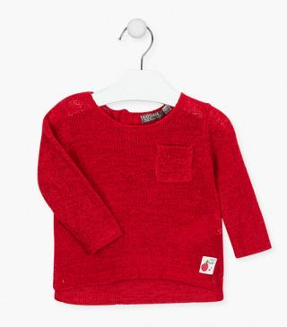 Knit jumper with a pocket at the chest.