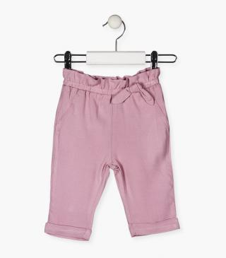 Pink trousers with a bow.