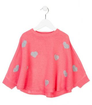 Poncho de color coral.