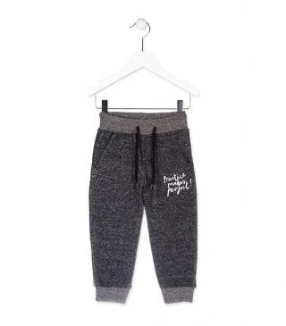 Grey trousers in plush.