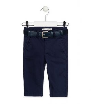 Blue skinny trousers with stretch belt.