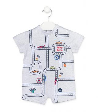 Ecru onesie with race track motif.