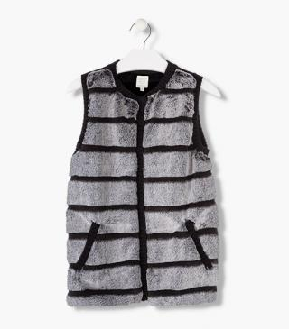 Fabric-mix vest in striped fleece and knit.