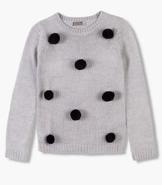 Knit jumper with pompoms.